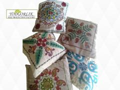 The pillows embroidered with handwork