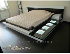 Bed in a bedroom from Korleone